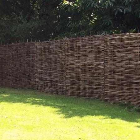Full hazel hurdle panels installed in a run