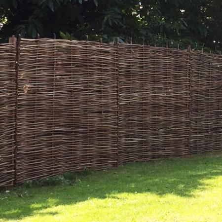 Full Hazel Hurdle panels installed in garden