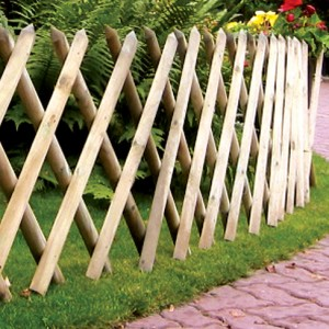 Half Round Expanding Trellis panel installed on garden path