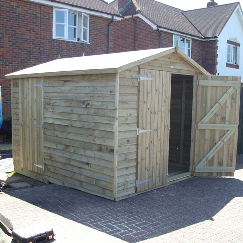 Double doors to front and single door in side of this gable weatherboard shed
