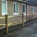 Installed Cleft Chestnut Post and 2 rail - detail in car park