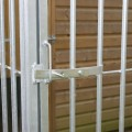 Close up detail of the door lock on the dog run galvanised bar cage