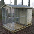 TATE Fencing gable roof Dog Run and Kennel has a roof over the whole dog run