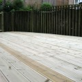 Grooved and reeded deck boards used to construct a large decking area