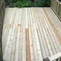 a top view looking down on a decking area installed using ex 38 x 150mm grooved and reeded deck boards