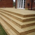 A patio decking area with decking steps made from our grooved and reeded softwood decking