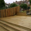A stepping deck installed by Tate Fencing for a customer using grooved and reeded deck boards