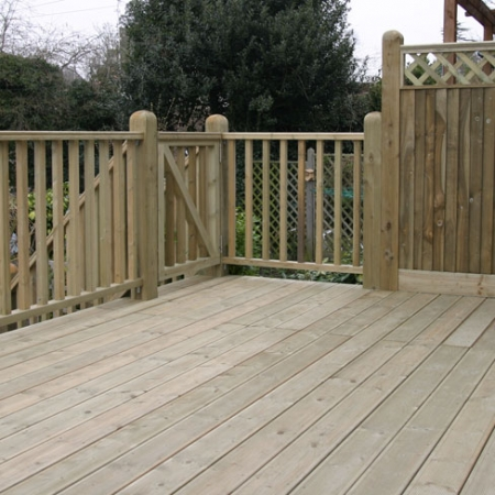 A grooved and reeded decking with Tate Fencing handrail and steps and a gate as the decking was raised high off the ground