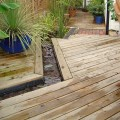 Detailed view of a deck installed using our Softwood bevelled decking boards.
