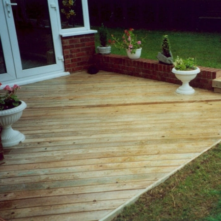 Tanalised bevelled decking installed as a decking, patio area for a customer.