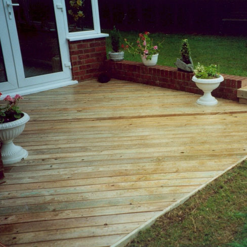 Softwood bevelled decking board decking boards tate for Tanalised decking boards