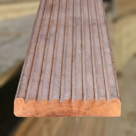 The grooved sides of 28 x 145mm Balau hardwood decking boards grooved and reeded