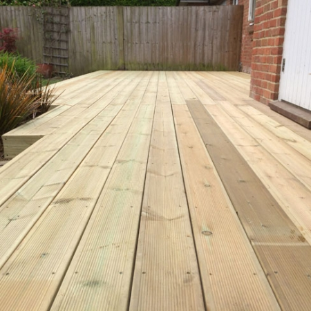 A patio area with a installed using our grooved and reeded softwood decking