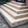A decking area with decking steps made from our grooved and reeded softwood decking