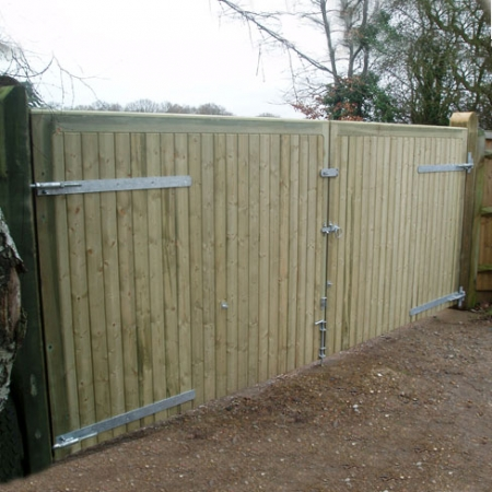 A pair of Richmond metal frame timber clad TGV gates, double clad showing hanging fittings.