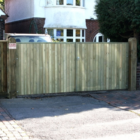 A pair of Richmond flat top metal frame tongue and groove gates installed.