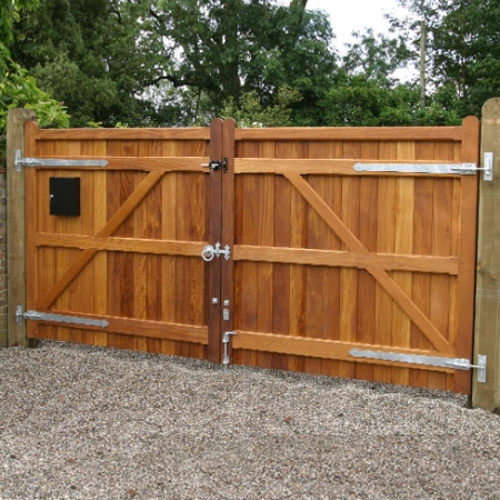 hardwood Iroko Wimborne gates with horns on the stiles.