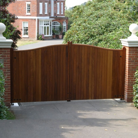 Iroko hardwood gates installed and automated on brick piers