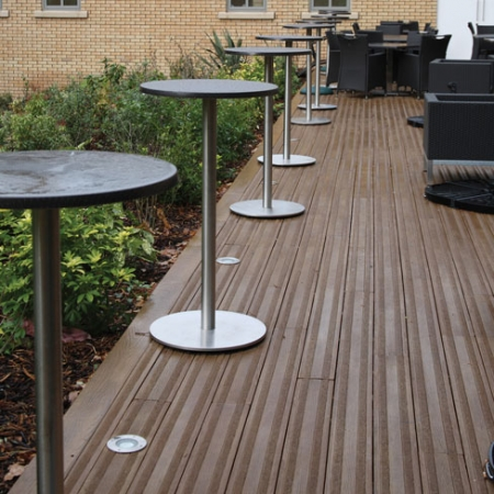 Seating area using Lasta Grip decking in Coppered Oak giving a stylish and contemporary non-slip finish