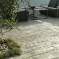 Weathered decking boards in Driftwood colour have been used to create a relaxed seating area