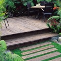 Vintage colour Weathered decking boards, individually used to create garden path leading to matching deck