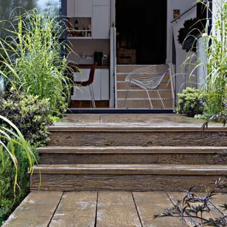 Weathered decking boards used to create steps into garden. Vintage colour has been chosen.