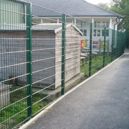 green powder coated security mesh installed by Tate Fencing