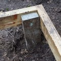 Concrete decking support post installed on site