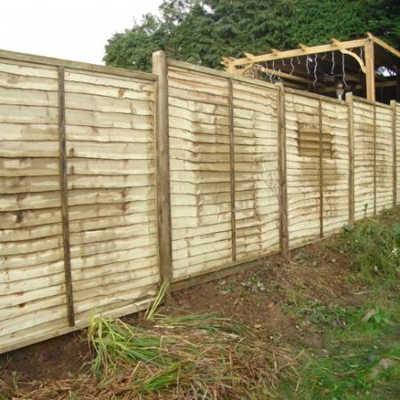 Installed Waney Edge Fence Panels in garden