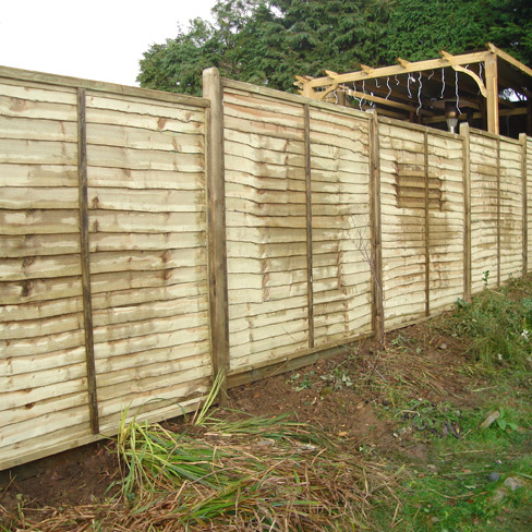 Installed Waney Edge Fence Panels in garden