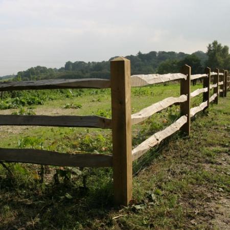 Installed chestnut rails on softwood posts - fence run, corner detail
