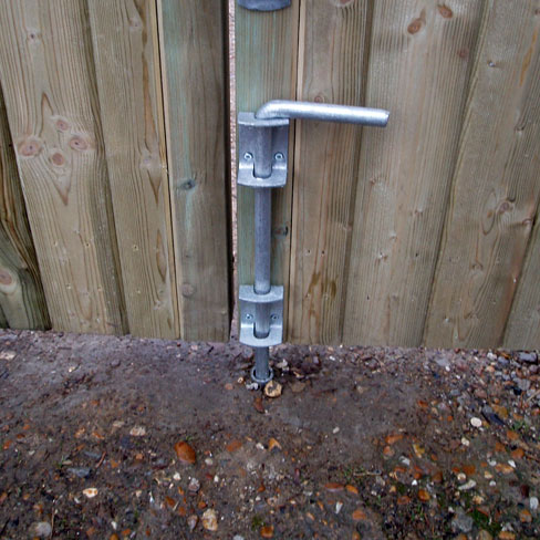 Drop bolt with drop bolt tube installed on a gate