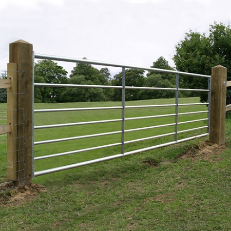 Galvanised metal field gate
