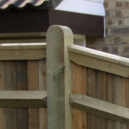 Showing the top counter rail and capping going into a fence post