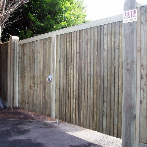 A pair of heavy frame closeboard gates with a solid flat top installed