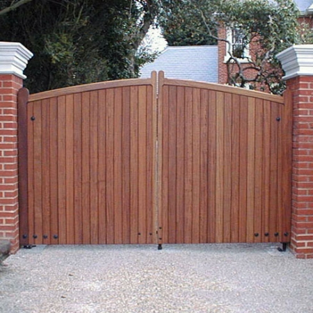 Iroko hardwood sherborne gates on brick piers installed by Tate Automation