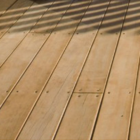 Close up of Radiata pine smooth and grooved decking installed