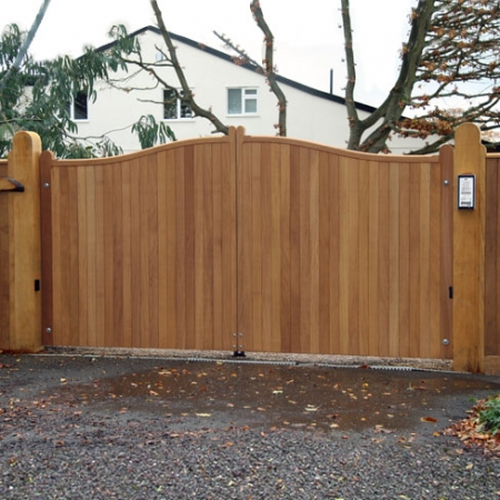 A pair of Iroko hardwood gates installed