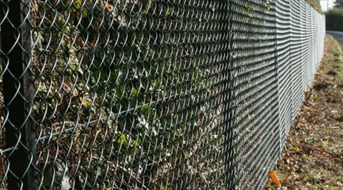 Green plastic coated Chain link fencing installed