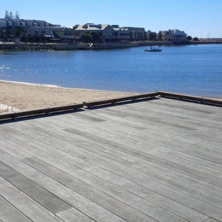 Enhanced Grain - Smoked Oak boards used to create decked area on sea front