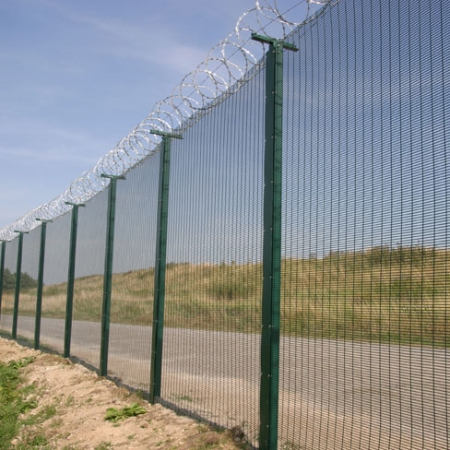 Security mesh fencing with razor wire on the top. installed by Tate Fencing for eurotunnel