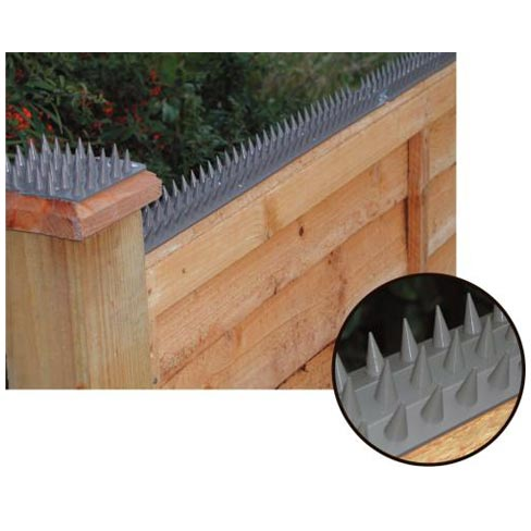 Prikka strip installed on top of a fence panel and post