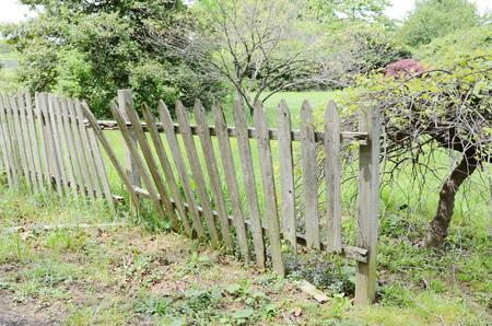 rotten broken palisade fence
